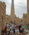 Photo caption: Summer Institute group together with Laziz Otayarov, the Uzbek guide and Professor Frank Griffel in front of the minaret of the Islam-Khoja madrasa in Khiva. Built in 1910 to a height of 185 feet, it is still one of the tallest buildings in Central Asia.